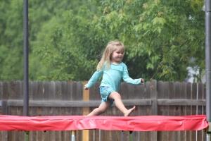 Amelia running on trampoline